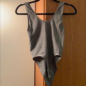 Grey body suit